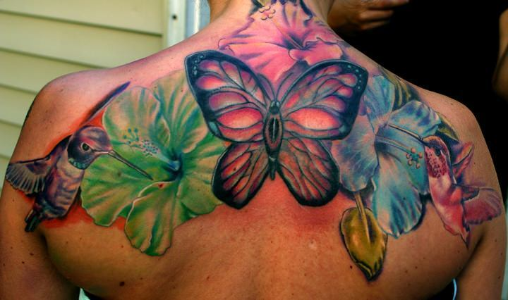 Hummingbirds hibiscus flowers and a butterfly make up for Feminine tattoos with meaning