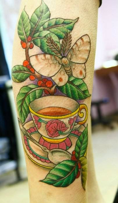 ... tea cup, a moth and a tree branch to commemorate a deceased loved one
