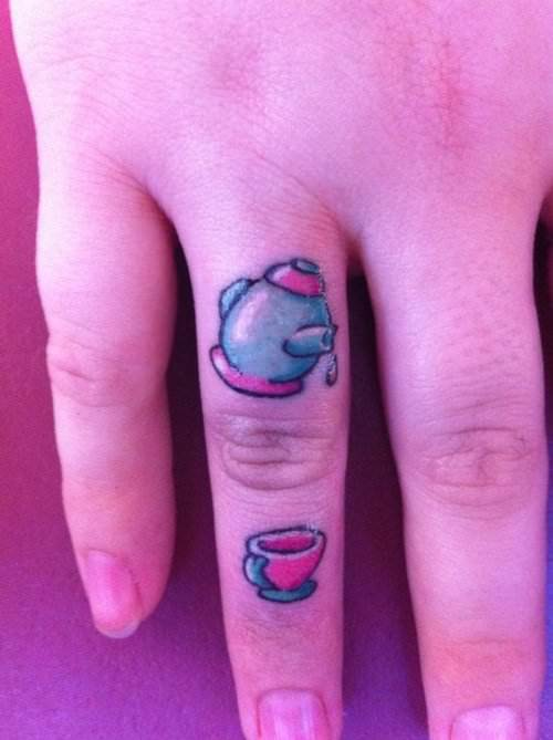 Two tiny tattoos of a tea pot and a tea cup make a cute finger tattoo design