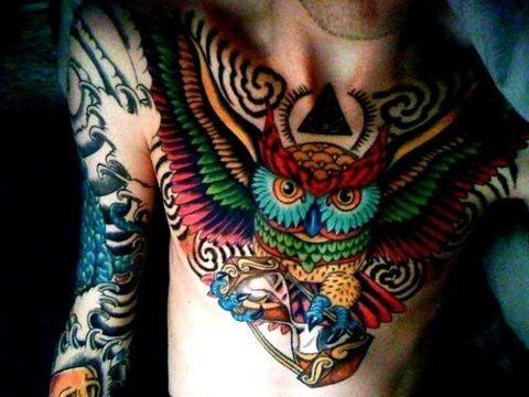 A colorful and creative bird tattoo of an owl holding an hourglass symbolizing wisdom and time