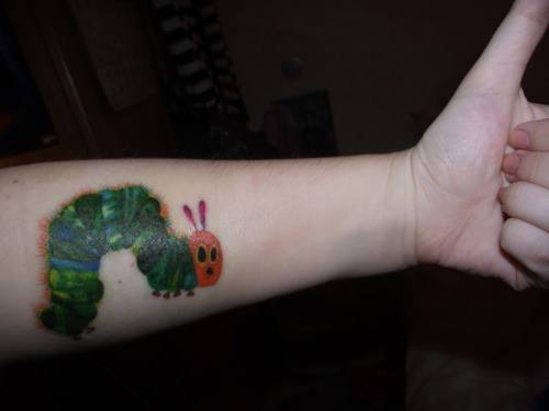 A colorful tattoo of the popular childrens book The Very Hungry Caterpillar