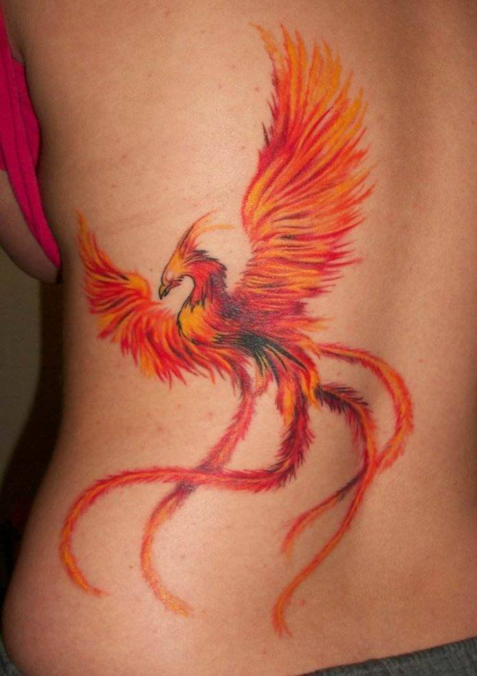 A phoenix rises from the ashes in this fire bird tattoo for Ashes in tattoo ink