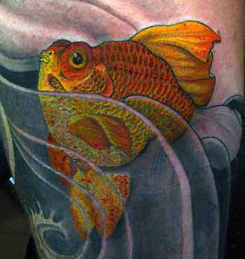 A tattoo of a golden ryukin goldfish in stylized water patterns