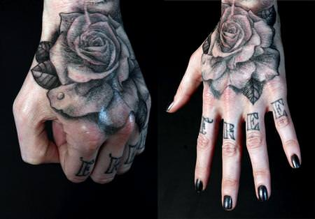 A black ink rose tattoo on the hand by Shawn Barber