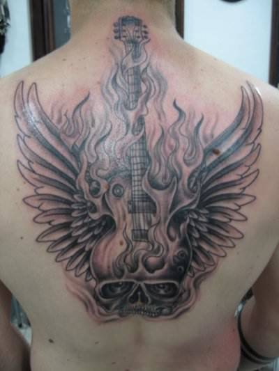 a flaming skull guitar tattoo with wings is a great design for people who enjoy rock guitar. Black Bedroom Furniture Sets. Home Design Ideas
