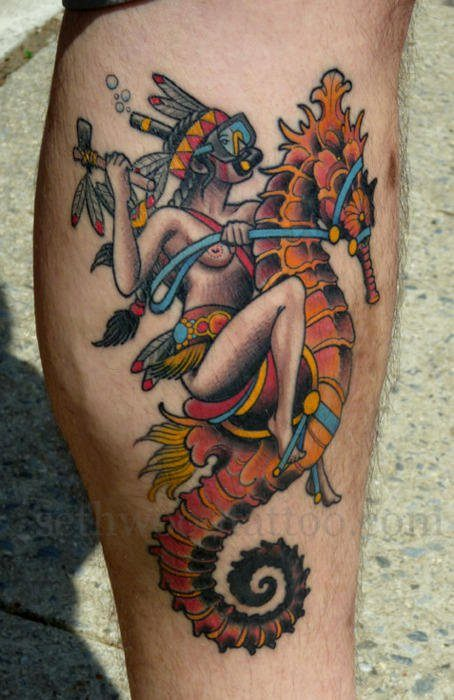 A fun tattoo design that shows a topless Native American girl riding a seahorse
