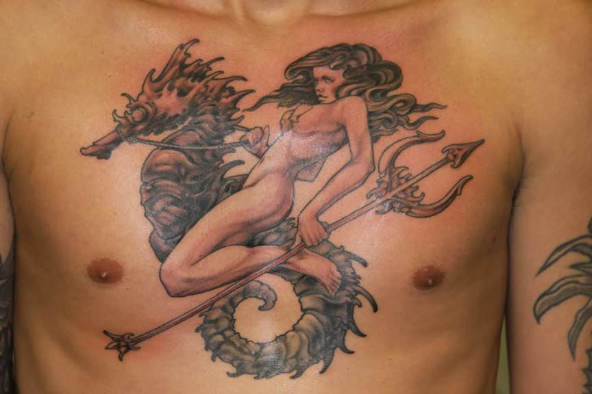 A sea goddess rides a seahorse and carries a trident in this large tattoo design