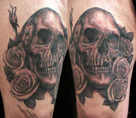 A skull sits among roses in this Shawn Barber tattoo design.
