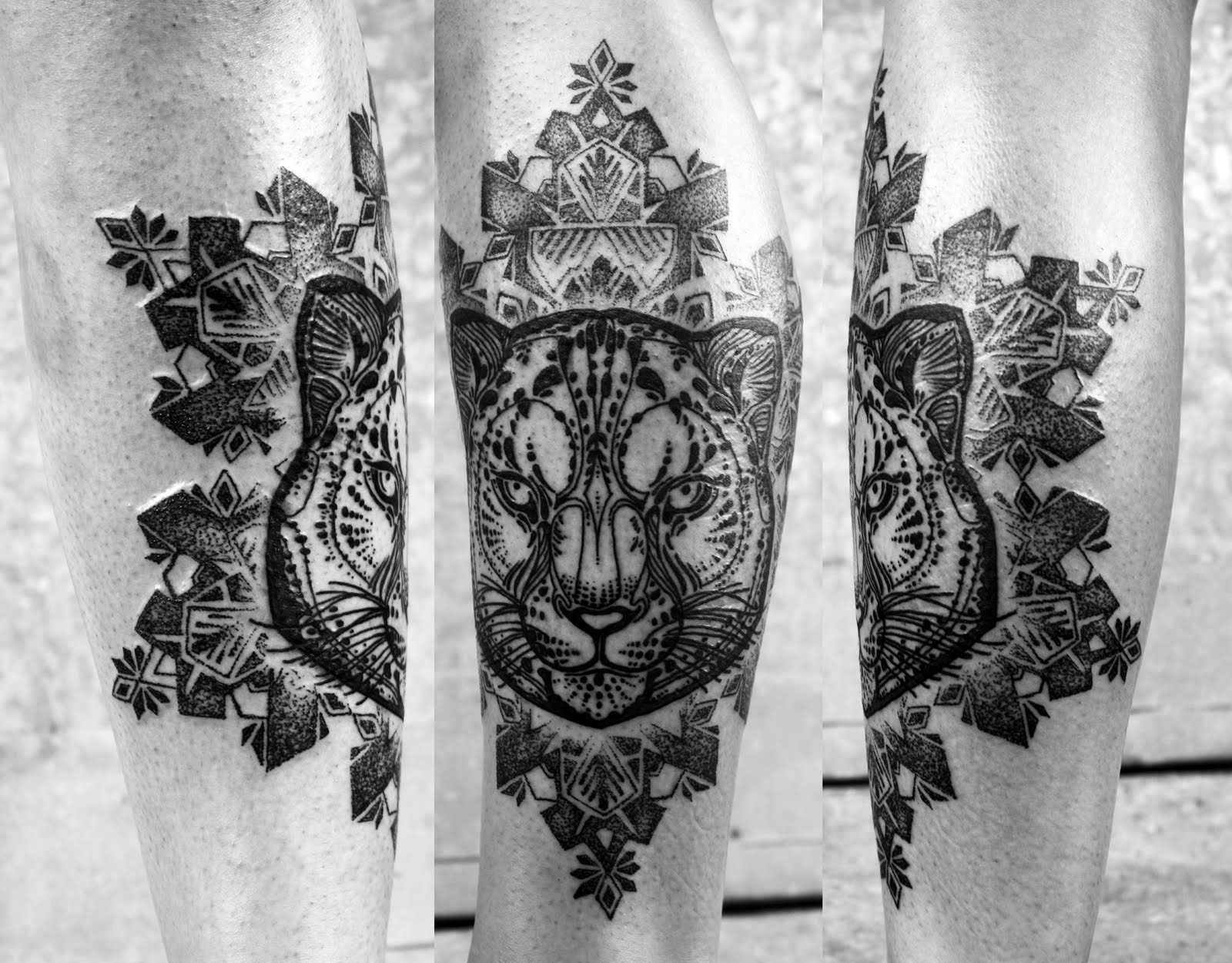 A tattoo of a snow leopard by David Hale with spiritual mandala patterns
