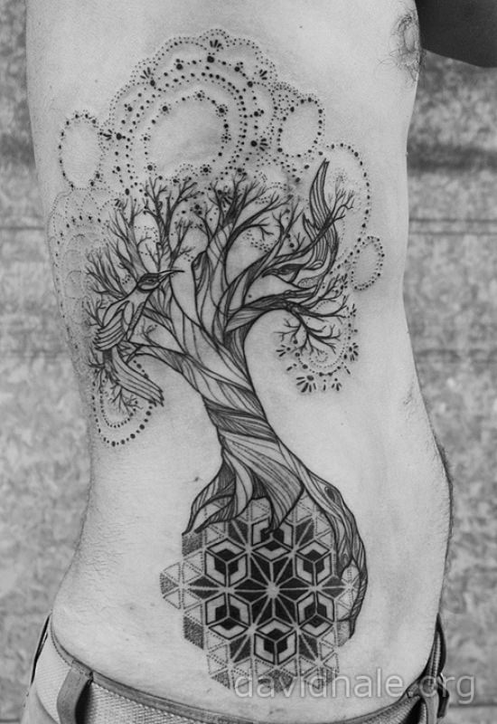 A tree of life tattoo by David Hale in which the tree grows on a mandala and has mandala leaves