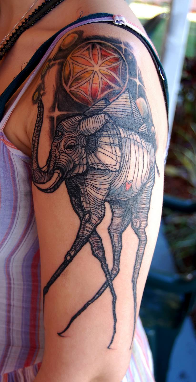 This David Hale tattoo is based on the long legged elephants painted by Salvador Dali