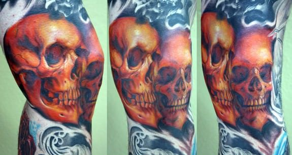 This knee tattoo of two human skulls shows off the high quality of Shawn Barbers tattoos