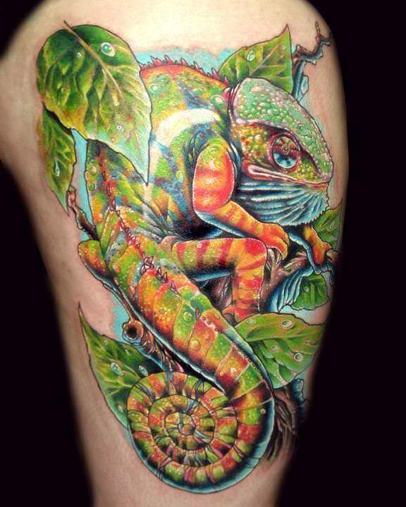 A colorful, highly detailed tattoo design of a chameleon lizard with a curled tail