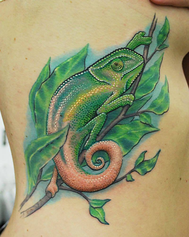 This stylized chameleon tattoo by Josh Hansen shows off the prehensile tail of the chameleon