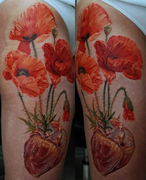 Poppy flowers grow out of a human heart in this photorealistic tattoo by Dmitriy Samohin