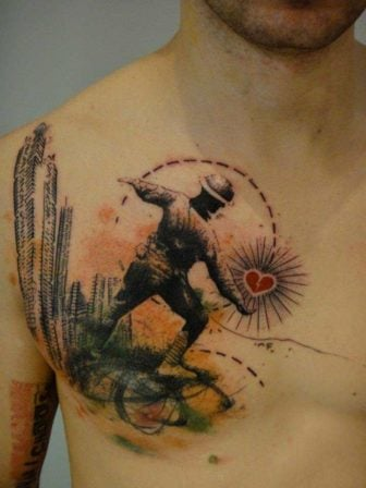 A soldier throws a heart at city buildings in this artistic abstract tattoo by Xoil