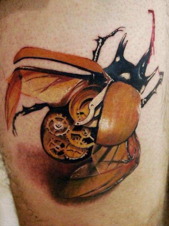 A stunning tattoo of a steampunk clockwork beetle by Alex de Pase