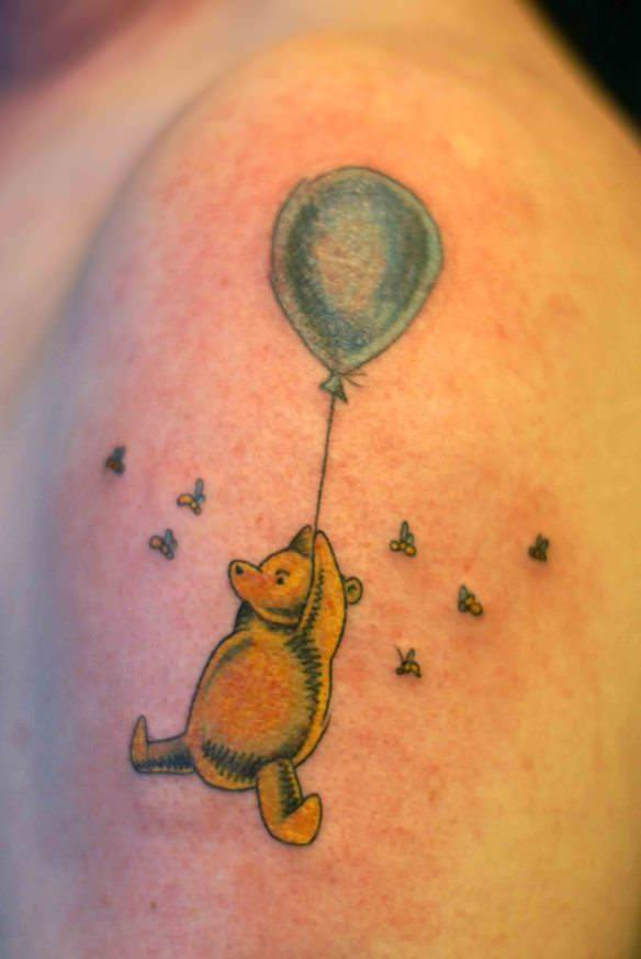 A tattoo by Shaun Christopher that shows Winnie the Pooh as originally illustrated by Shepard
