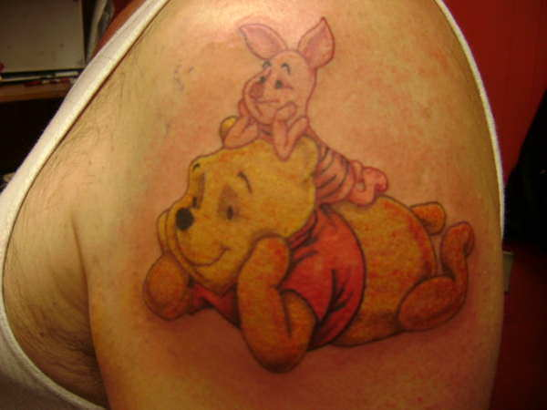 Best friends Winnie the Pooh and Piglet chill out together in this cute tattoo