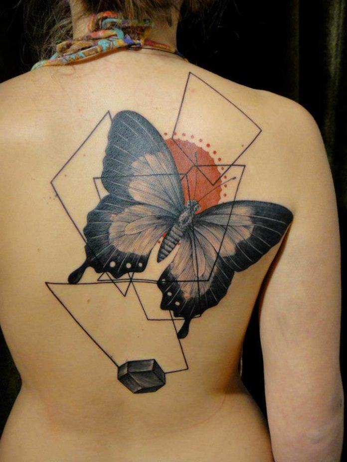 Tattoo artist Xoil combines a butterfly with graphic designs to create this artistic abstract tattoo design