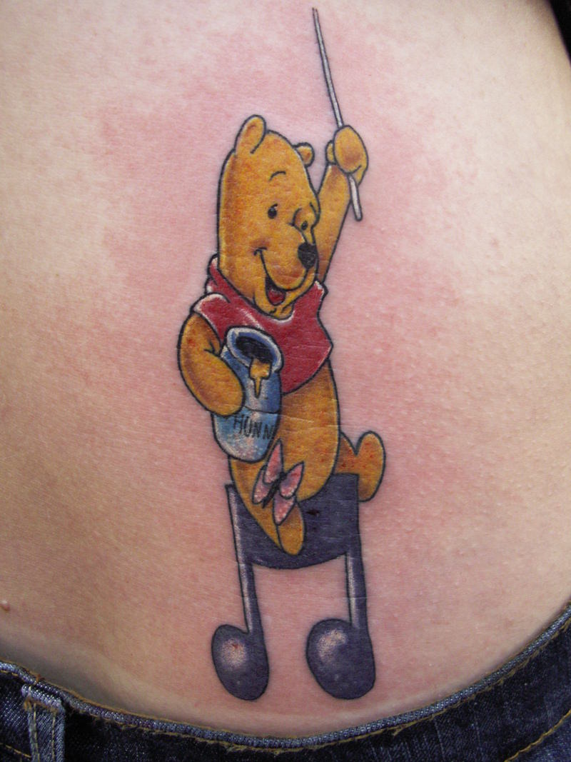 This Winnie the Pooh tattoo shows Pooh Bear directing music while holding his favorite honey pot