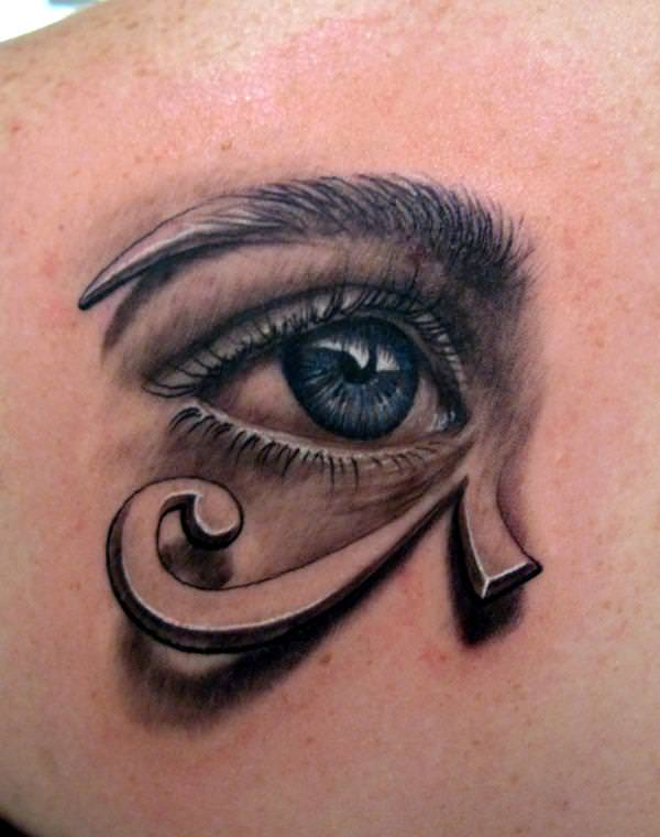 This artistic tattoo combines a realistic eye and graphic of the Eye of Horus patterns