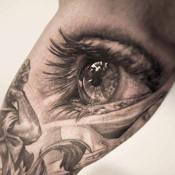 this awesome photo realistic eye tattoo is by niki norberg. Black Bedroom Furniture Sets. Home Design Ideas