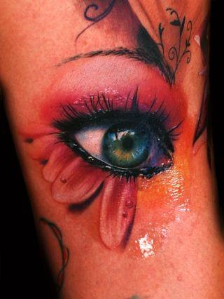 This breathtaking color tattoo design of a photo-realistic eye is by Alex de Pase