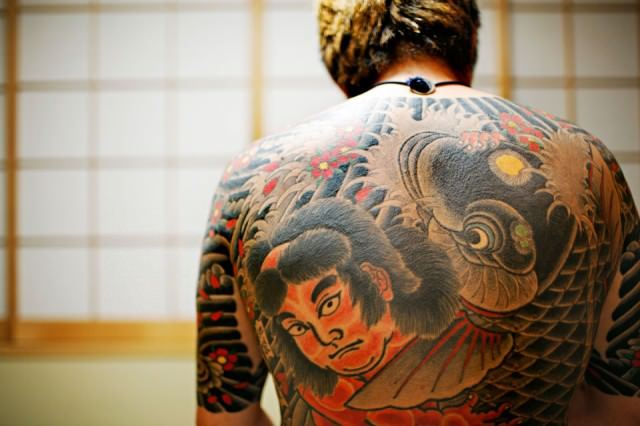 This yakuza tattoo design stops at the neck and elbows so that it can be hidden beneath clothing