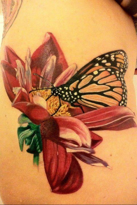 A beautiful butterfly and flower tattoo based on a botanical drawing