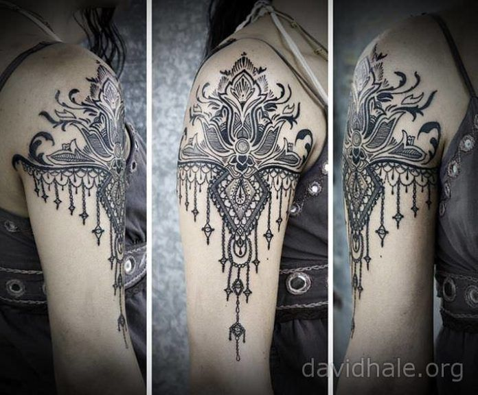 Paisley and lace designs converge in this beautiful tattoo by artist David Hale