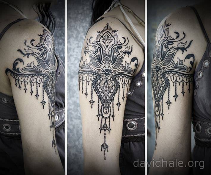 Paisley and lace designs converge in this beautiful tattoo for Gothic neck tattoos