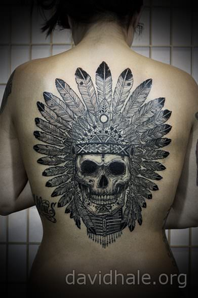 The skull of a Native American witch doctor is the focus of this illustrated tattoo by David Hale