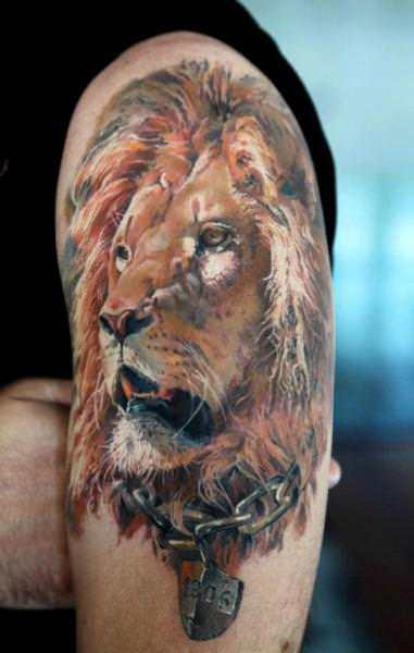 This stunning photo realistic tattoo of a lion symbolizes inner strength about to break free