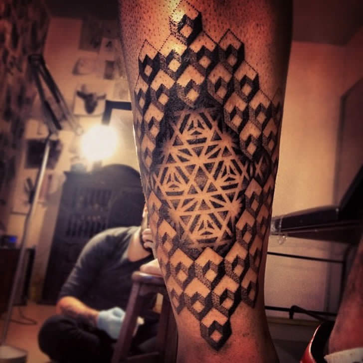 A beautiful, geometric optical illusion tattoo by Gregorio Marangoni