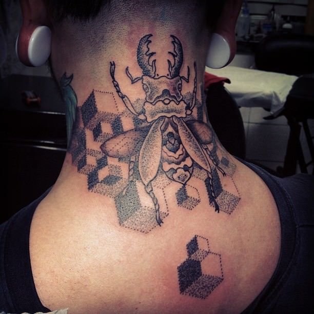 A beetle and optical illusion cubes feature in this dot work tattoo by Gregorio Marangoni