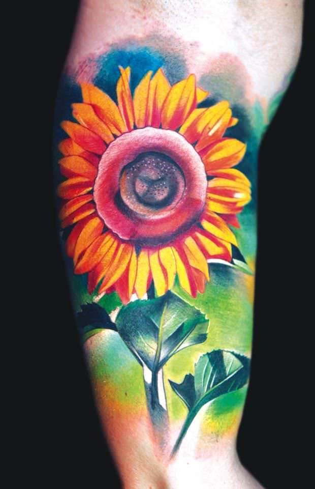 A bright and colorful tattoo of a cheerful sunflower by Ivana Belakova