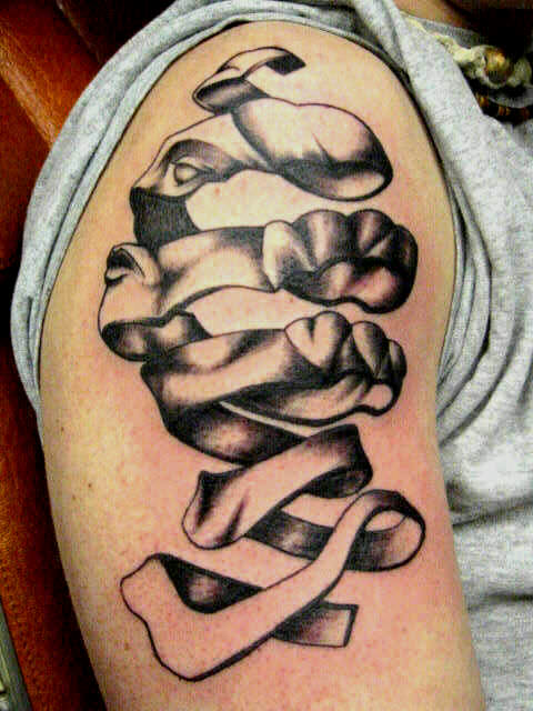 A famous optical illusion by MC Escher becomes a tattoo design