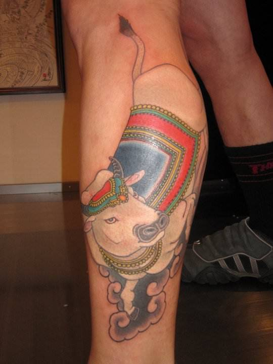 A holy cow becomes a perfect leg tattoo in this body art work by Hide Ichibay