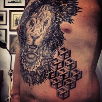 A lion, mandala and impossible object illusions combine in this pointillism tattoo by Gregorio Marangoni
