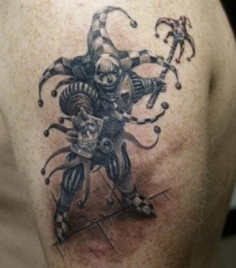 A medieval fantasy jester gets an evil grin in this black and white tattoo by Robert Litcan