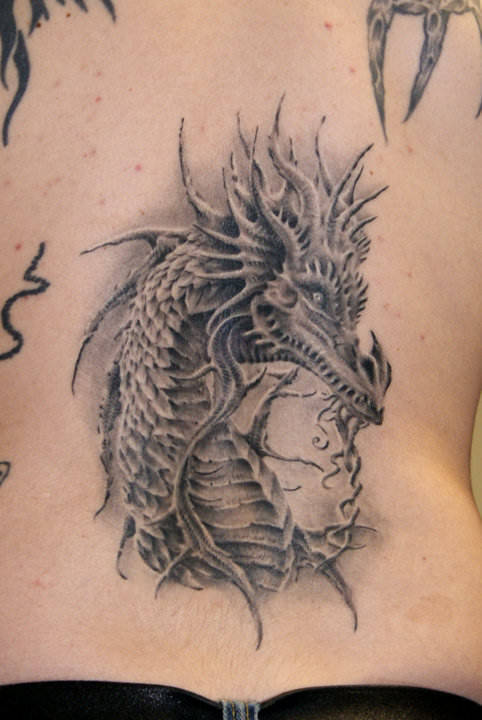 A photo realistic tattoo design of a Western dragon by Robert Litcan