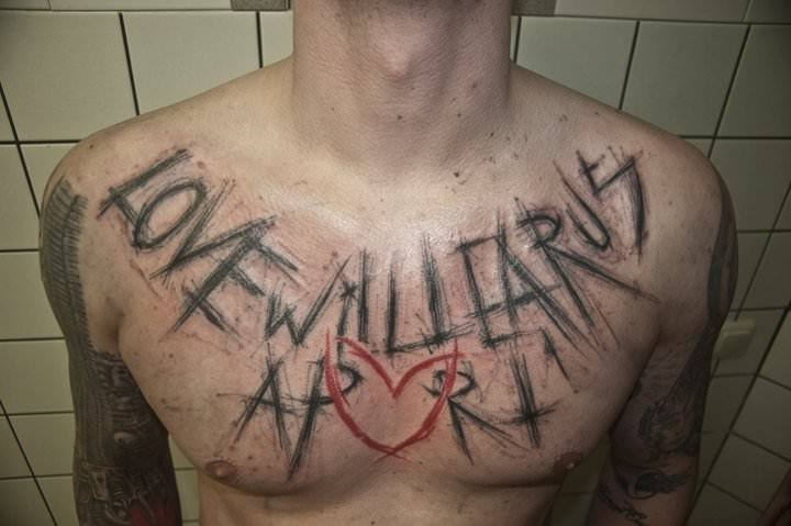 A Scratchy Text Tattoo By Berliner Sven Groenewald That Reads Love Will Tear Us Apart