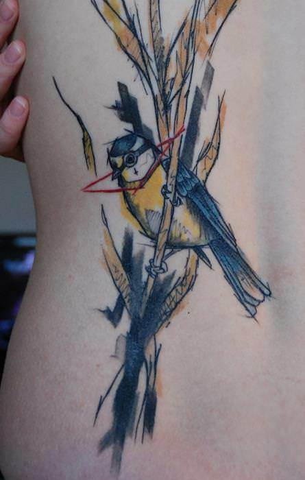 A watercolor painting becomes an abstract body art work in this tattoo of a bird on a reed by Sven Groenewald