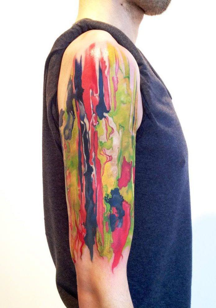 Amanda Wachob transfers a wet paint abstract painting to skin in this artist arm tattoo