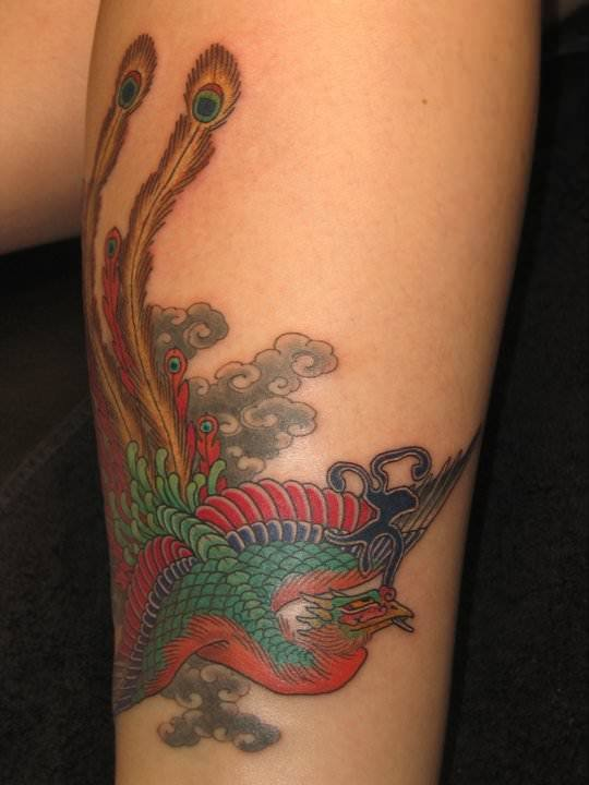 An Asian peacock takes on a Japanese style in this bird tattoo by Hide Ichibay