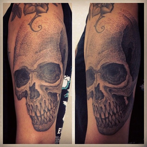 Gregorio Marangoni gives this human skull tattoo an interesting texture by using thousands of tiny dots