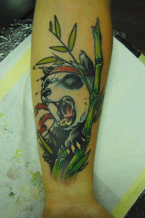 Tattoo artist Jukan combines humor and animal symbolism in this tattoo of a ninja panda bear