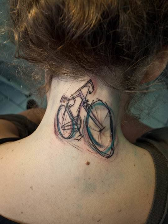 Tattoo artist Sven Groenewald from Berlin creates a bicycle body art work