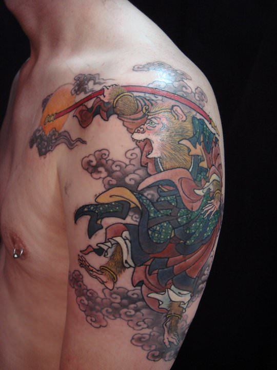 Tattoo by Hide Ichibay of a baboon in a Japanese illustration style